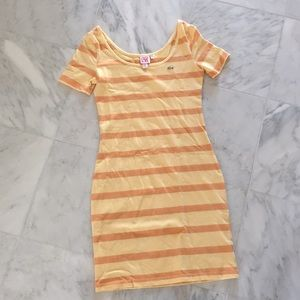 Hello and orange stripped body con Lacoste dress.